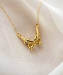 Gold Holding Hands Necklace